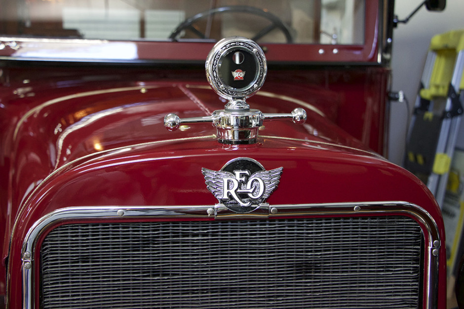 The hood ornament and badging for the 1929 REO Speedwagon Camper.