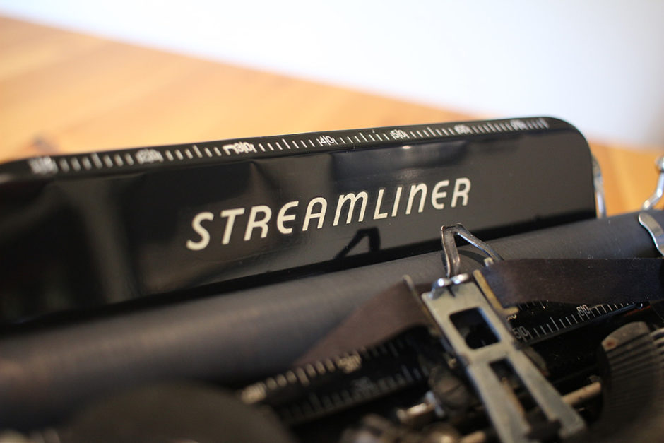 Logo from the mid-to-late model Remington Rand Streamliner Typewriter.
